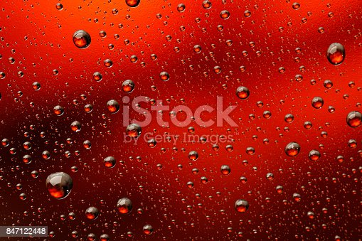 Ice cold glass fresh beer covered with water drops condensation  Cold drink Drops of water Orange drink background Raindrops texture Close up