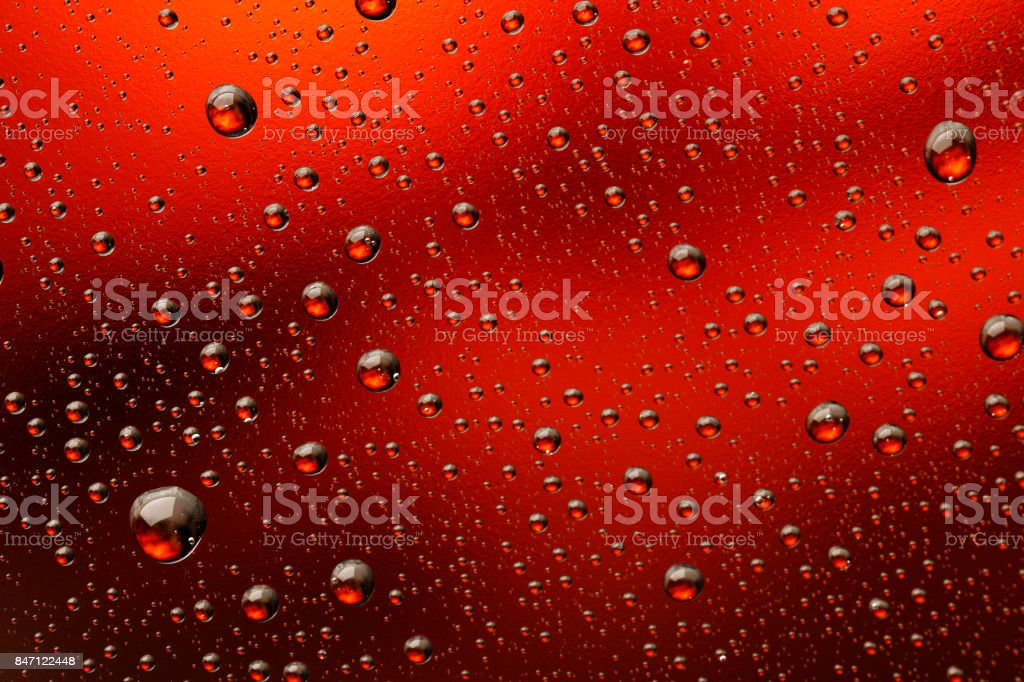 Ice cold glass fresh coca cola covered with water drops condensation  Cold drink Drops of water cola drink background Raindrops texture Close up stock photo