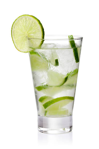 Ice cold lemonade with fresh lime slices isolated on white cold fresh lemonade.  Isolated on white background with clipping path tonic water stock pictures, royalty-free photos & images