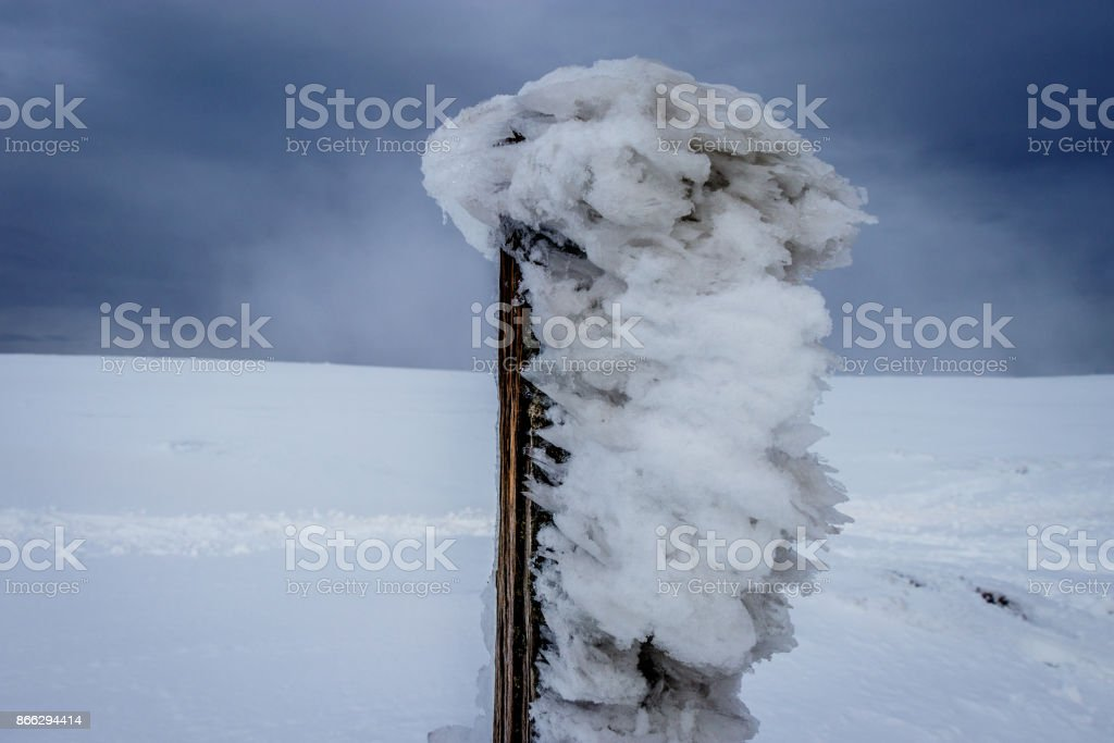 Ice covered fence posts stock photo