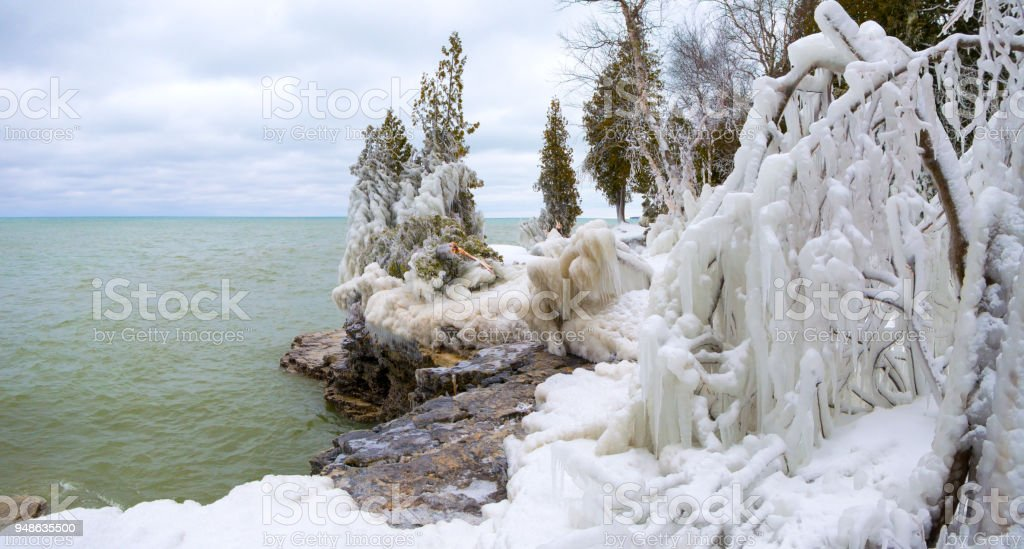 Ice Covered Landscape Trees And Branches By Lake After Blizzard Stock Photo  & More Pictures of Awe