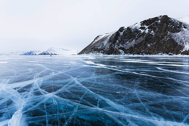 Ice cracks on Baikal surface stock photo