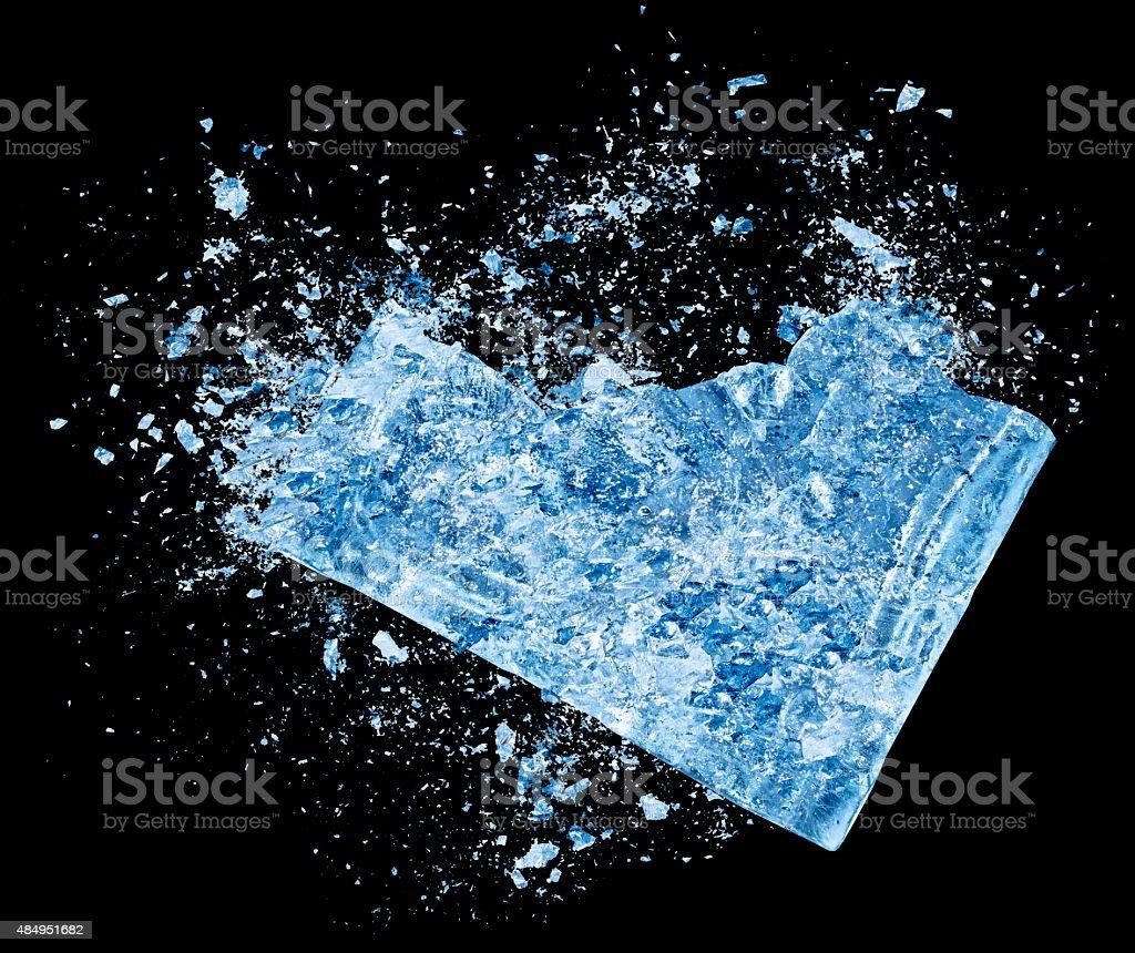 Ice crash explosion parts on black background stock photo