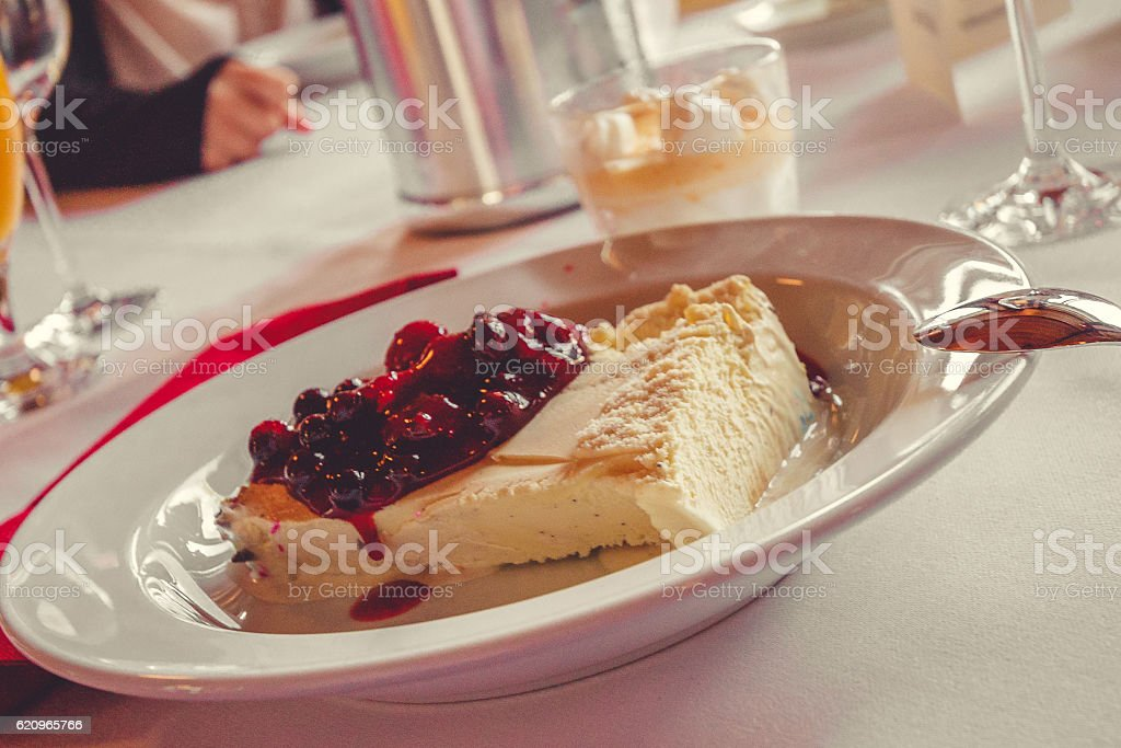 Ice Cream and berry sauce stock photo