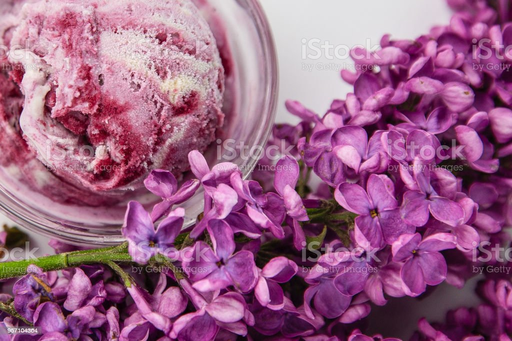 ice cream and lilac flowers spring background stock photo