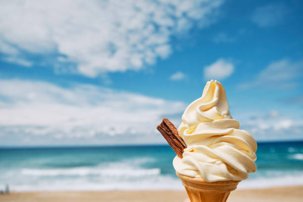 ice cream at fistral beach, newquay, cornwall on a bright sunny june day. - ice cream cone stock photos and pictures