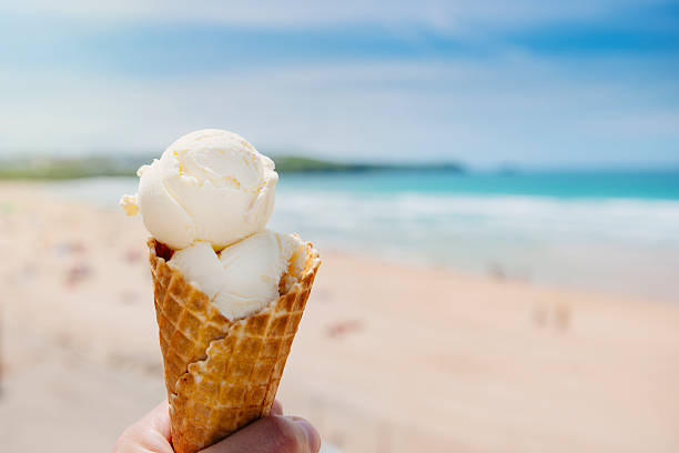 ice cream at fistral beach, newquay - ice cream cone stock photos and pictures