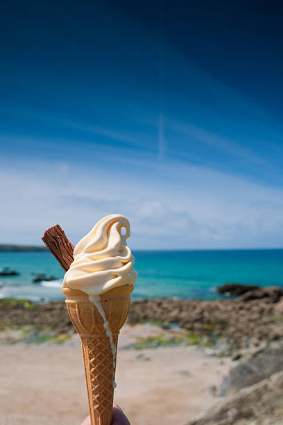 ice cream at the beach - ice cream cone stock photos and pictures