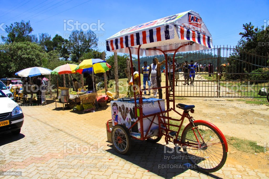 Ice Cream Bicycle Cart and other vendors selling fruits stock photo