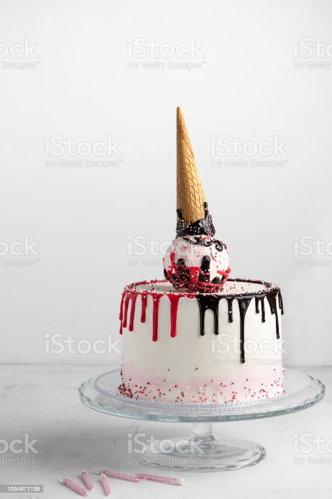 Ice Cream Cone Birthday Layer Cake On A White Background With Candles Vertical Free Space For Text Celebration Concept