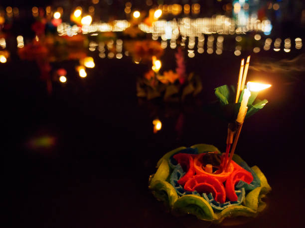 Ice cream cone krathong with candle at night stock photo