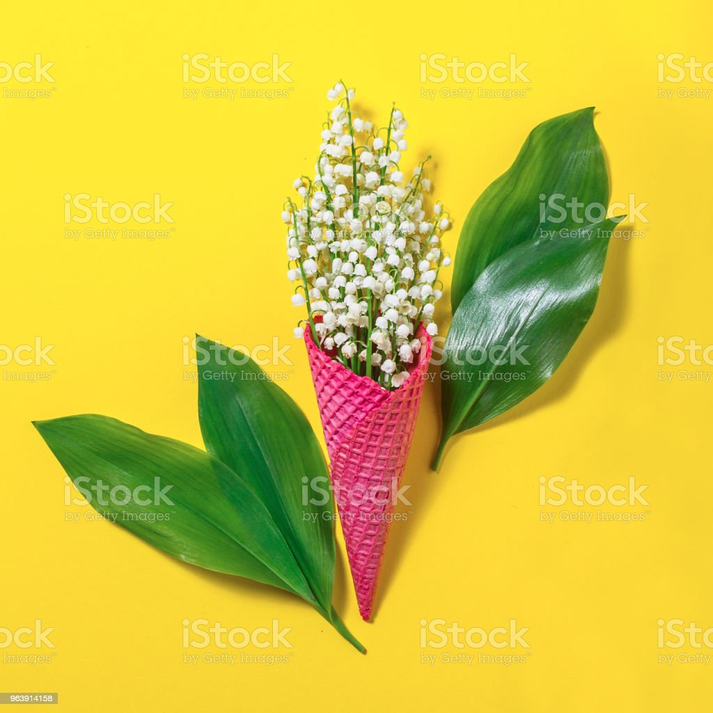 Ice Cream Cone With Lily Of The Valley Flowers On A Yellow