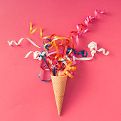 istock Ice cream cone with party streamers 579150914