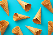istock Ice cream cones pattern. Turquoise background. Sweet, summer and empty concept. Top view. Flat lay 685046158