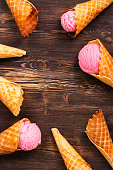 istock Ice cream in waffle cones over wooden background 526717906