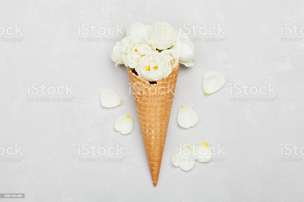 Ice cream of rose flowers in waffle cone, floral decoration stock photo