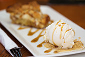 Ice cream scoop with apple pie and caramel