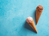 istock ice cream scoops in cones with copy space on blue 1222008258