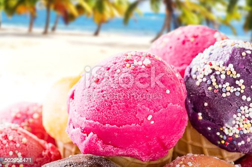 istock Ice cream scoops on sandy beach. 502958471