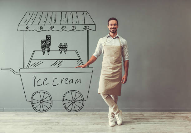 ice cream seller - apron stock pictures, royalty-free photos & images
