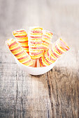 istock Ice cream sticks on wooden background. Popsicles sorbet ice-cream with copy space 675823446