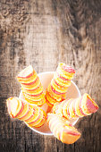 istock Ice cream sticks on wooden background. Popsicles sorbet ice-cream with copy space 675823448