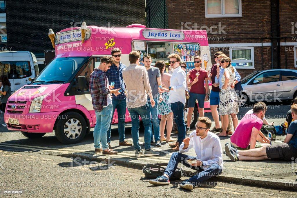Ice cream van and people sitting stock photo