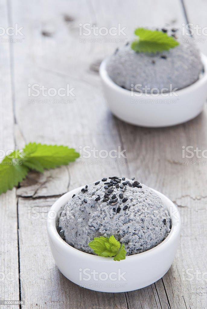 Ice cream with black sesame seeds stock photo