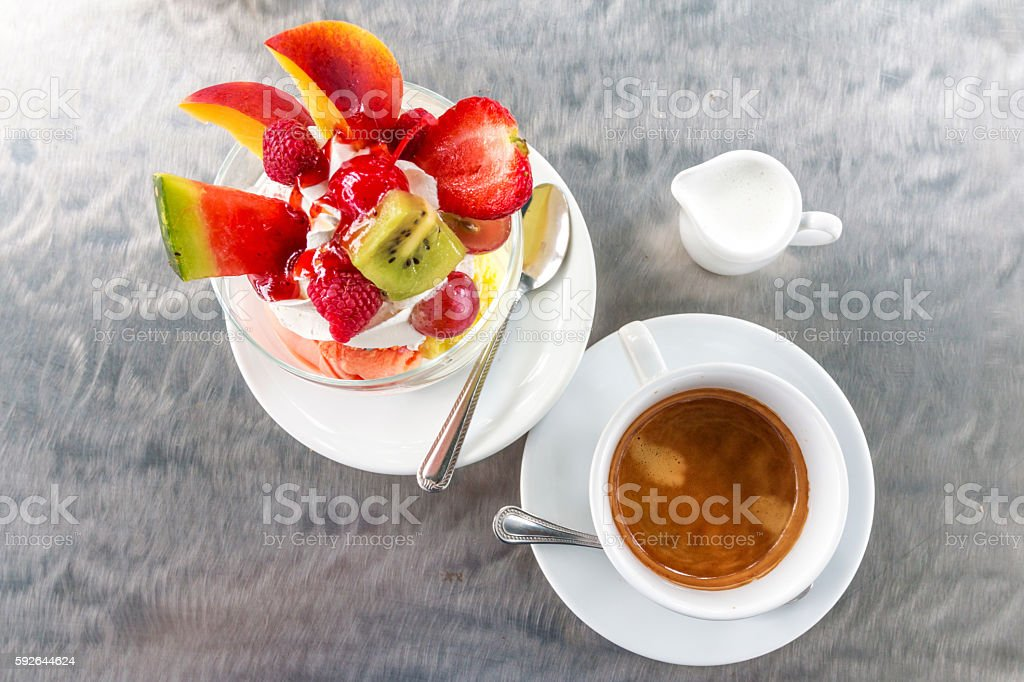 Ice cream with friuts and a cup of coffee stock photo