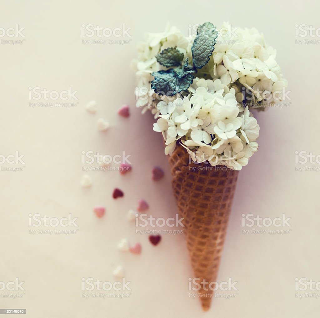 Ice cream's imitation in waffle cone decorated mint leaves. stock photo
