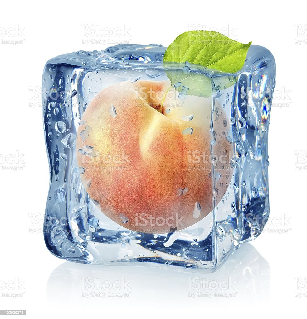 Ice cube and peach isolated stock photo