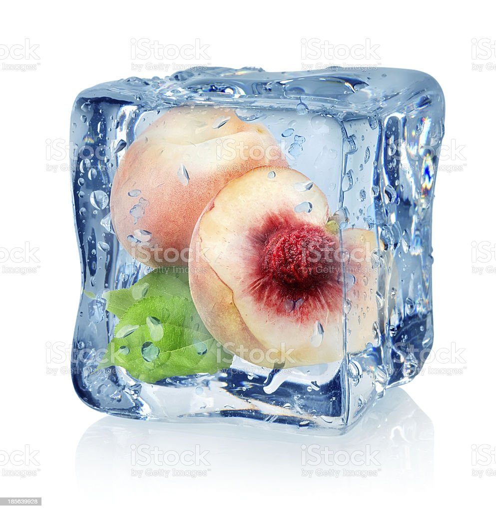 Ice cube and peach stock photo
