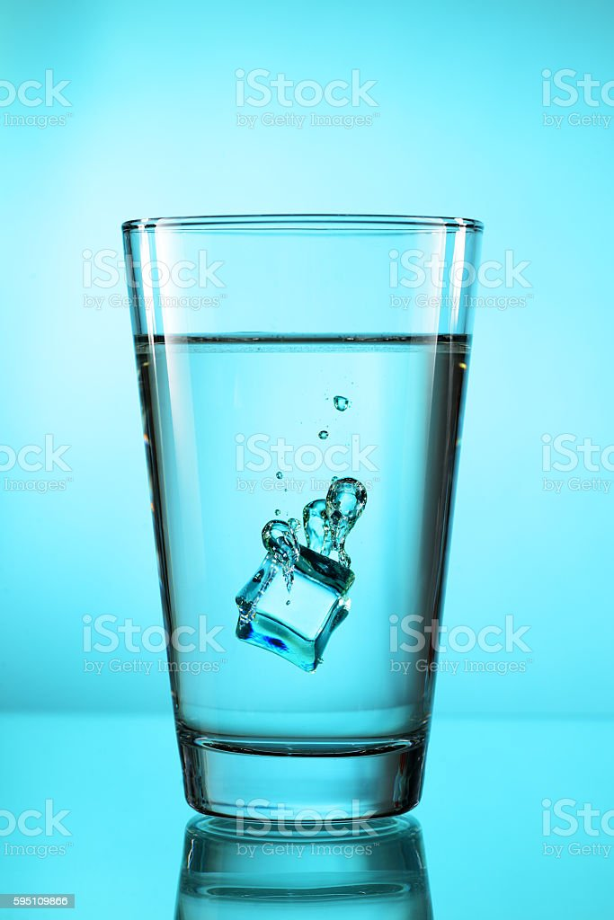Ice cube in glass stock photo
