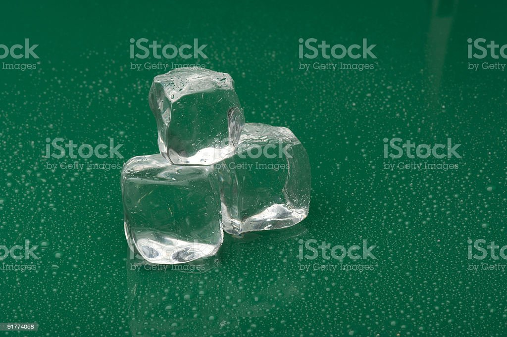 ice cube on green background royalty-free stock photo