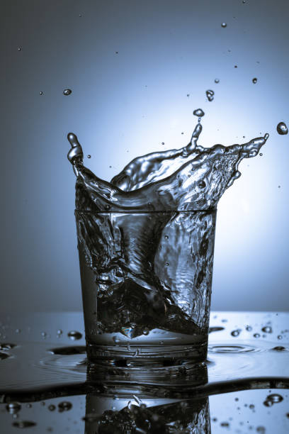Ice Cube Splash into Drink stock photo