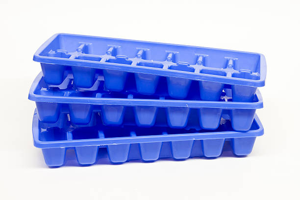 ice cube trays stock photo