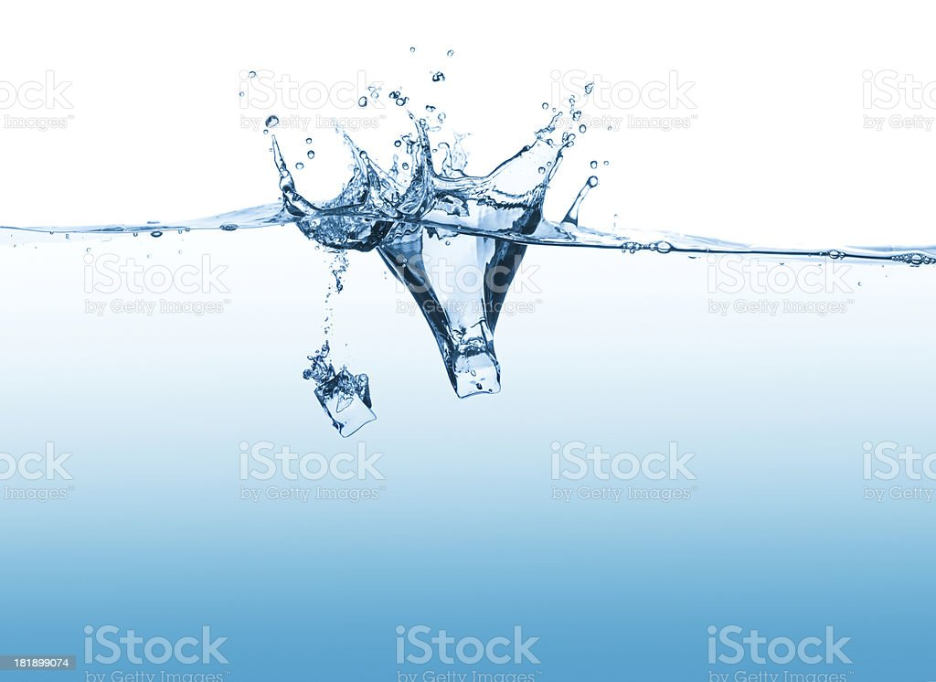 Ice cubes drop into water royalty-free stock photo