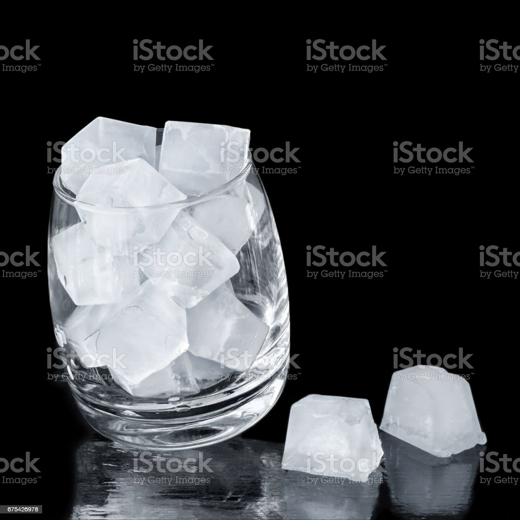 Ice cubes in a glass on a black background. Cropping into a square photo libre de droits