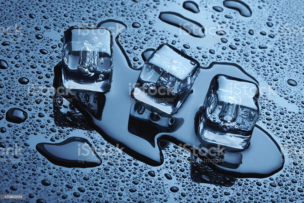 Ice cubes over dark background royalty-free stock photo