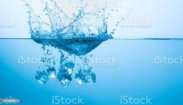 Photo of Ice cubes splashing into the water