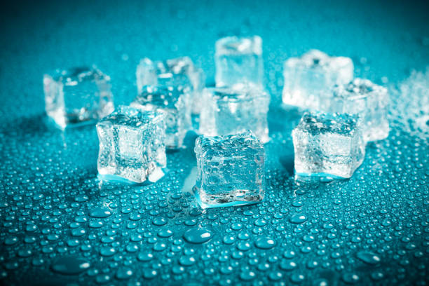 Ice cubes with drops stock photo
