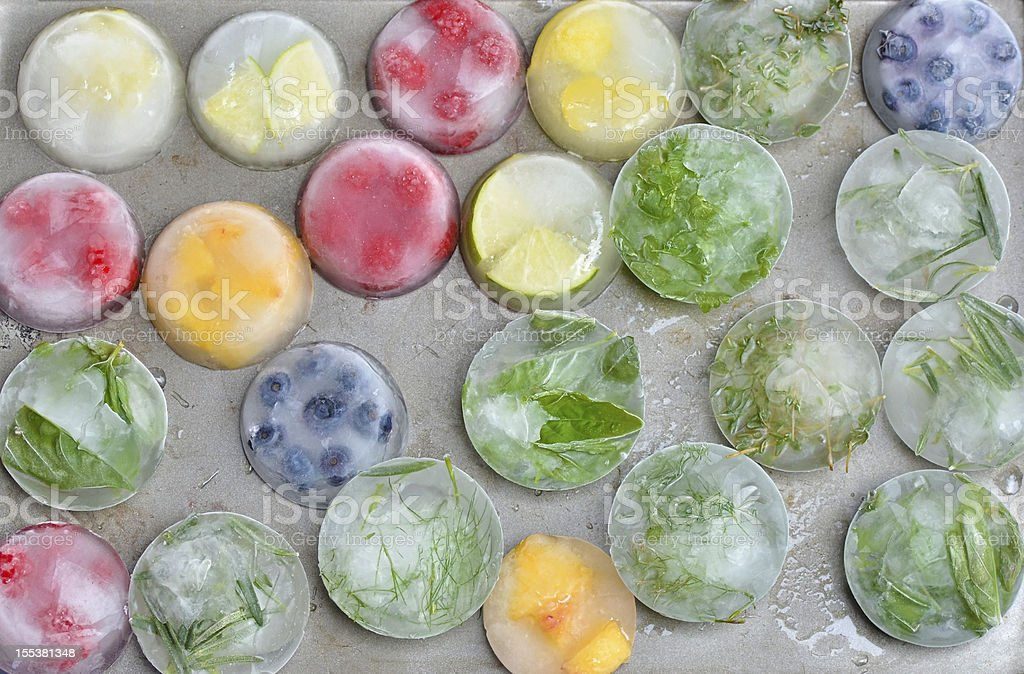 Ice Cubes with Fresh Fruit and Herbs stock photo