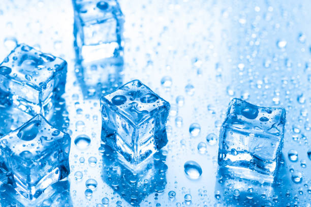 Ice cubes with water drops stock photo