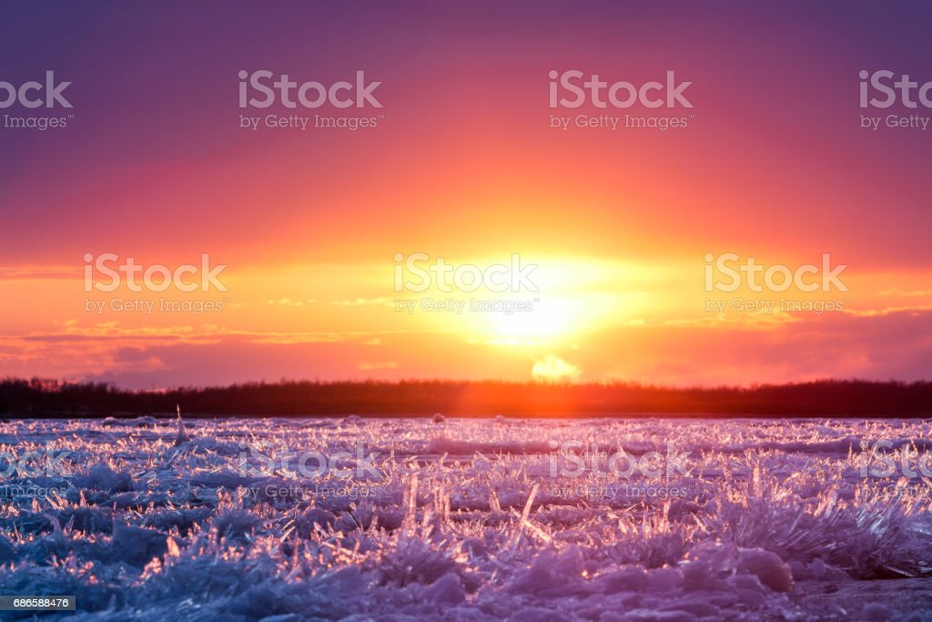 Ice drift begins. River ice at colorful sunset royalty-free stock photo