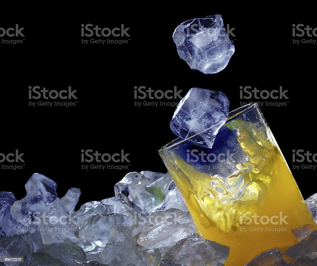ice fall in orange juice royalty-free stock photo