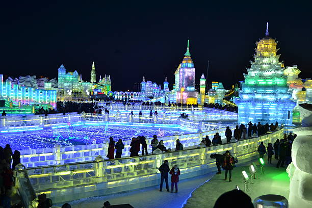 Ice Festival at night Harbin, China, 02/04/2014, International Ice Festival at night. Different illuminated iced sculptures displayed in the northeastern city of Harbin, China during their winter festival. harbin stock pictures, royalty-free photos & images