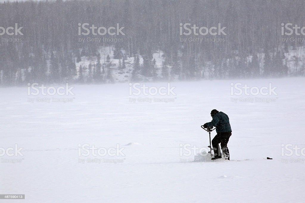 Ice fisherman on Waskesiu Lake stock photo