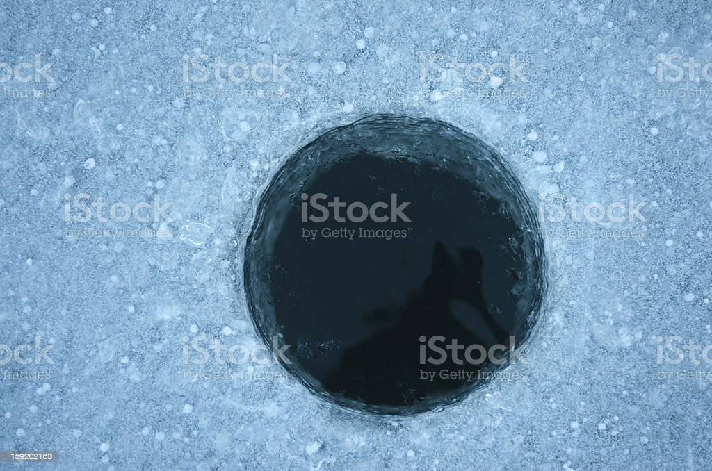 Ice Fishing Hole stock photo