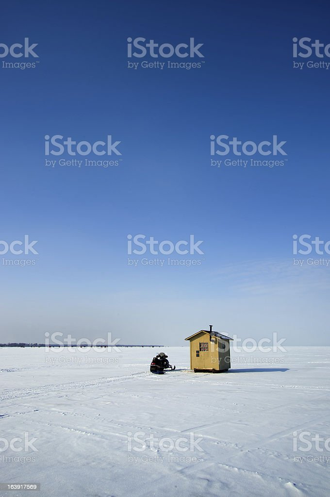 Ice fishing hut on a lake stock photo