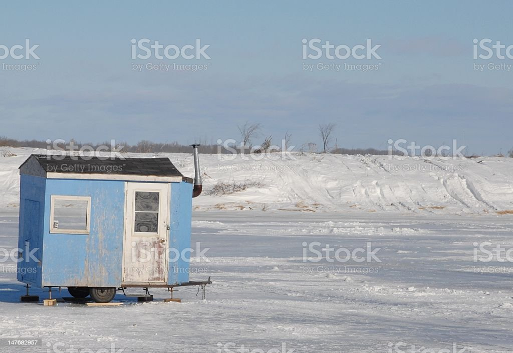 ice fishing hut stock photo